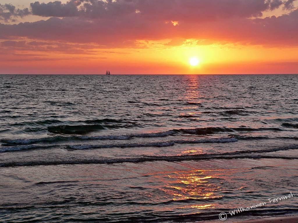 Sonnenuntergang am Strand von Naples, Golfküste, Florida